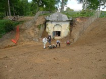 Volutneers dig to reveal the walls of the Mausoleum, 2013